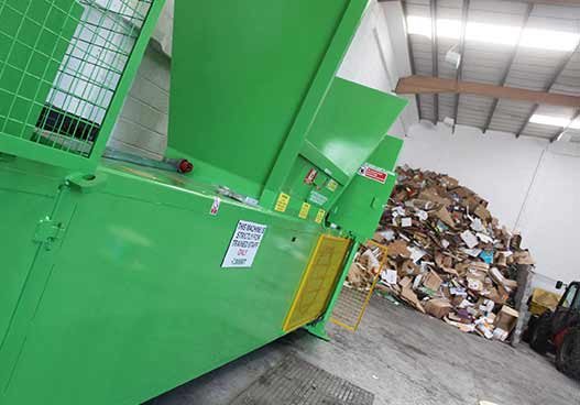 massive green cardboard compactor installed by phs wastekit enginerrs