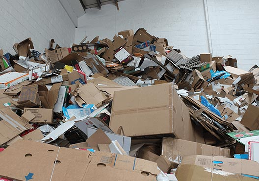 large pile of waste recyclable cardboard