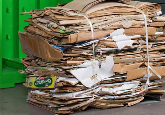 large pile of compacted cardboard recyclable waste